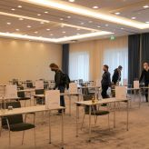 "Event participants of ""Made in Berlin"" in a conference room with parliamentary seating at Novotel Berlin Tiergarten"