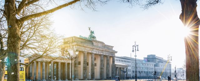 Berlin Brandenburg Gate in Winter while sun is shining