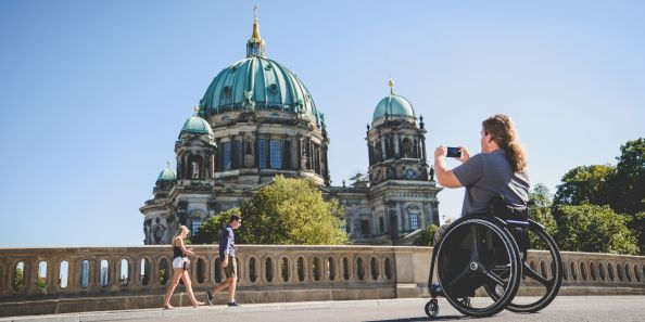 Blog Berlin Meetings, holding a meeting without barriers in Berlin, wheelchair users in front of the Berlin Cathedral