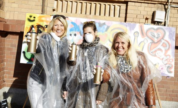 Services Berlin Convnetion Office Incentives in Berlin - Graffiti Workshop, three participants with spray can in hand