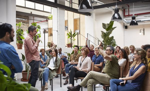 Interactive business meeting in a relaxed atmosphere with plants in the background