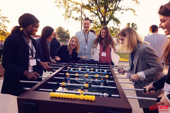 Blog Berlin Meetings, event service provider in Berlin, group of young people at the table football